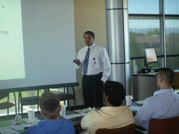 Patrick Rendon giving a presentation to the Interns